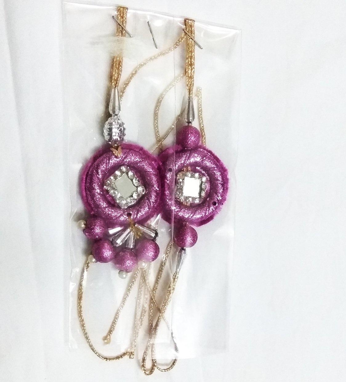 Purple rakhi for bhaiya and Bhabhi-1