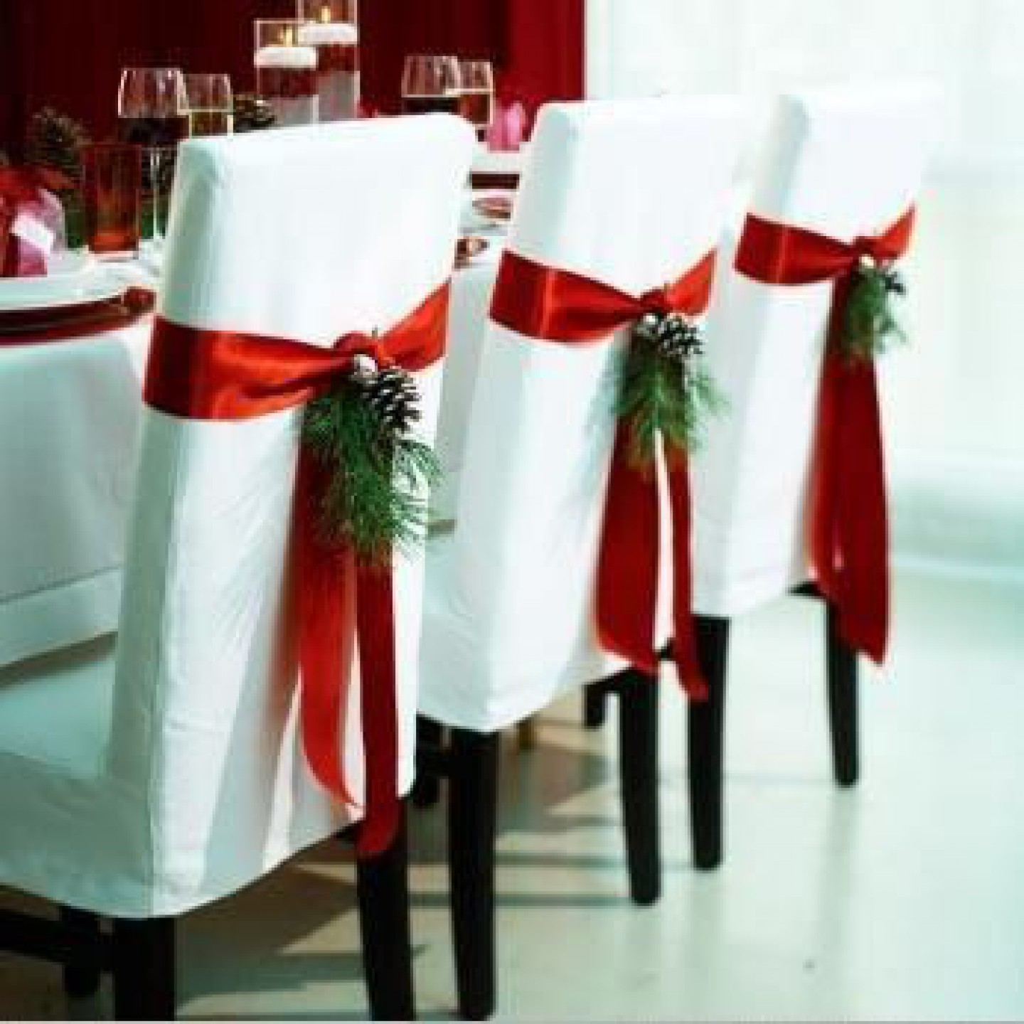 Wrap bows around dining room chairs