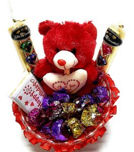 Chocolates and teddies for her