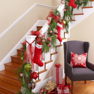 Family-stockings-and-Christmas-ornaments-turn-the-staircase-into-a-focal-point