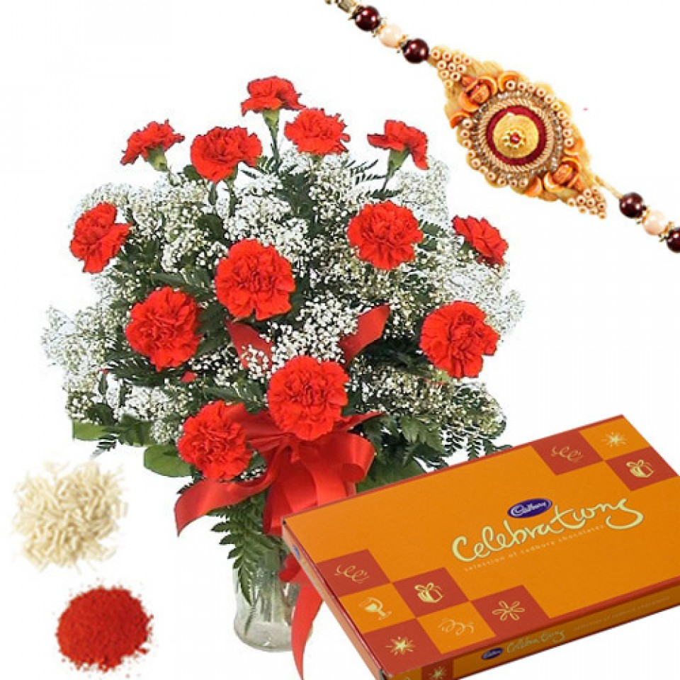 Rakhi with flowers and chocolates