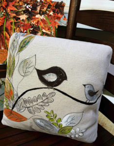 A hand-painted pillow cover