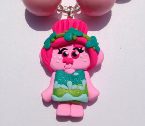 Doll pendant for a doll