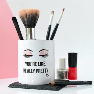 Makeup brush and pot